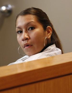 Elizabeth Escalona, 23, sits in a courtroom to be sentenced, in Dallas, Monday, Oct. 8, 2012. Escalona pleaded guilty on July 12, 2012, to injury to a child and is facing up to life in prison.  A doctor has testified that the Texas mother glued her 2-year-old daughter's hands to a wall and beat the toddler so badly that she suffered significant brain trauma and bleeding inside her skull. (AP Photo/LM Otero)