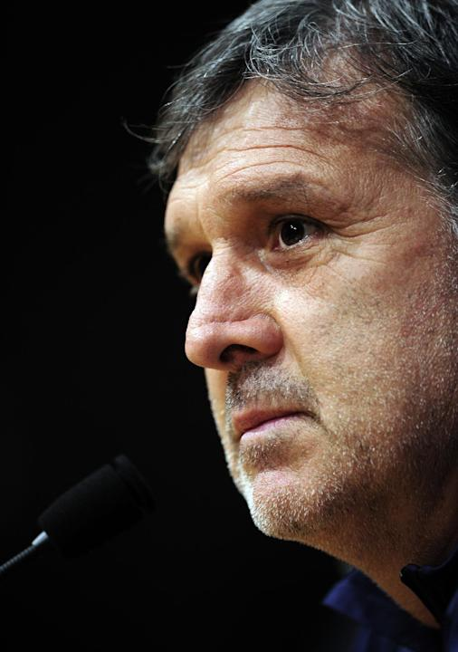 Barcelona's coach Gerardo Tata Martino from Argentina  before a press conference at the Camp Nou in Barcelona, Spain, Tuesday, Nov. 5, 2013.  FC Barcelona will play against AC Milan in a group H Champ