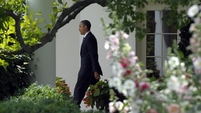 President Barack Obama walks out of Oval Office of the White House in Washington, Monday, June 4, 2012,  to the Marine One on the South Lawn, on his way to attend fundraisers in New York City. (AP Photo/Susan Walsh)