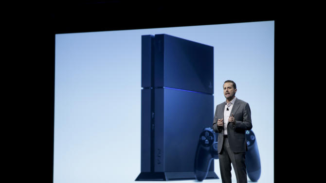 Sony Computer Entertainment president and CEO Andrew House addresses the media as he stands in front of a display showing the images of the new PlayStation 4 at the Sony PlayStation E3 media briefing in Los Angeles, Monday, June 10, 2013. Sony is giving gamers their first look at the PlayStation 4 and it's a rectangular black box, just like all the previous PlayStations. (AP Photo/Jae C. Hong)