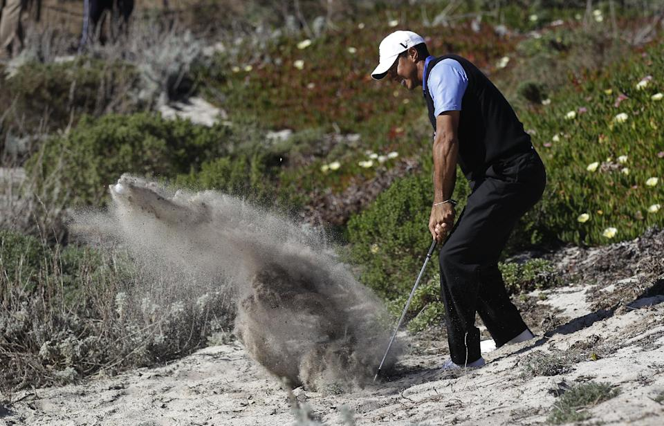 Tiger Woods hits from the rough toward the fourth hole at Spyglass Hill Golf Course during the first round of the AT&T Pebble Beach National Pro-Am golf tournament in Pebble Beach, Calif., Thursday, Feb. 9, 2012. (AP Photo/Marcio Jose Sanchez)
