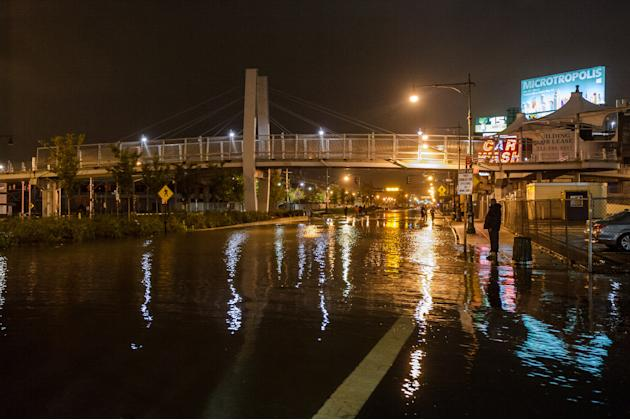 This photo provided by Dylan Patrick shows flooding along the Westside Highway near the USS Intrepid as Sandy moves through the area Monday, Oct. 29, 2012 in New York. Much of New York was plunged int
