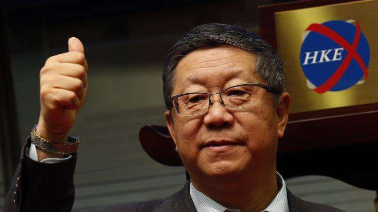 China Everbright Bank's Chairman Tang gestures during the debut of the bank at the Hong Kong Stock Exchange