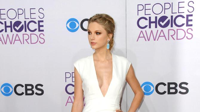 """FILE - This Jan. 9, 2013 file photo shows Taylor Swift at the People's Choice Awards at the Nokia Theatre in Los Angeles. Swift says you can expect some of her bolder choices of late, from her music to her new, sexier image, to be incorporated in her upcoming tour. Swift kicks off her worldwide tour in Omaha, Neb., next month in support of her latest album, """"Red.""""  (Photo by Jordan Strauss/Invision/AP, file)"""