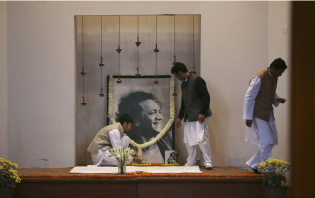 Disciples of legendary Indian sitar player Ravi Shankar put up his portrait for a prayer meeting to pay him tributes at his music center, in New Delhi, India , Wednesday, Dec. 12, 2012. Shankar, who i