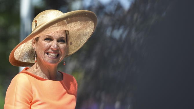 Dutch Queen Maxima is greeted as she arrives at Frederik Meijer Gardens & Sculpture Park in Grand Rapids, Mich., Tuesday, June 2, 2015. (Taylor Ballek/The Grand Rapids Press via AP) ALL LOCAL TELEVISION OUT; LOCAL TELEVISION INTERNET OUT