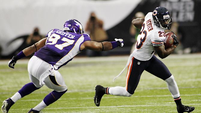 Chicago Bears wide receiver Devin Hester (23) runs from Minnesota Vikings defensive end Everson Griffen during the first half of an NFL football game, Sunday, Dec. 9, 2012, in Minneapolis. (AP Photo/Andy King)