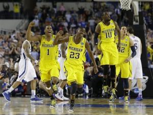 Burke leads UM rally over Kansas, 87-85 in OT