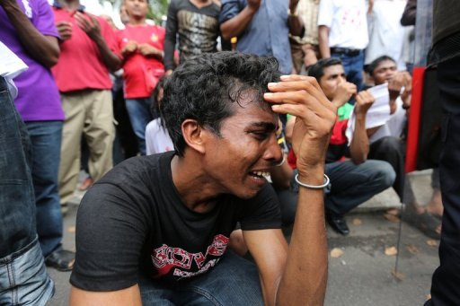 <p>An ethnic Myanmar Rohingya Muslim living in Malaysia cries during a protest over the persecution of Rohingya Muslims in Myanmar, outside the Myanmar embassy in Kuala Lumpur on August 3. Myanmar has set up a new commission to probe sectarian clashes that saw scores killed and displaced tens of thousands, members told AFP, following intense scrutiny of its handling of the issue.</p>