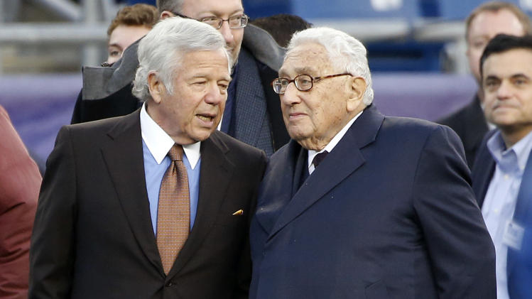 New England Patriots owner Robert Kraft, left, speaks with former Secretary of State Henry Kissinger on the sidelines at Gillette Stadium before an NFL football game against the Indianapolis Colts, Sunday, Nov. 18, 2012, in Foxborough, Mass. (AP Photo/Michael Dwyer)