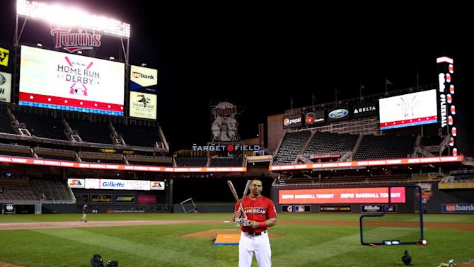 American League All-Star Yoenis Cespedes of the Oakland A's celebrates with the trophy after winning the Gillette Home Run Derby at Target Field on July 14, 2014 in Minneapolis, Minnesota