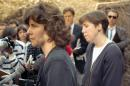 FILE - In this March 20, 1990, file photo, Isabella Stewart Gardner Museum director Anne Hawley, left, and curator Karen Haas, right, react during a news conference at the museum where thieves stole a number of priceless art treasures in an early morning heist. Twenty-five years after the theft the art is still missing and the mystery has not yet been solved. (AP Photo/Lisa Bul, File)
