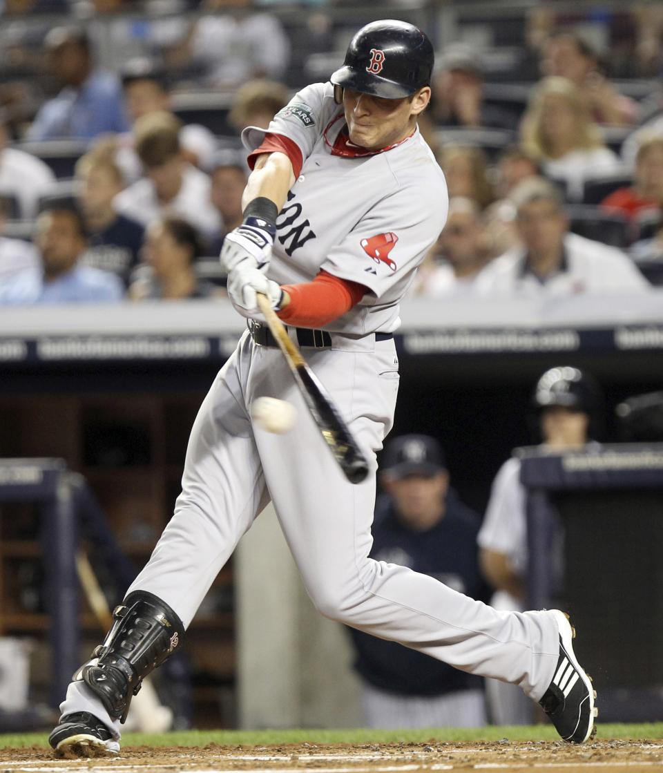 Boston Red Sox's Ryan Sweeney hits an RBI double during the second inning of a baseball game against the New York Yankees at Yankee Stadium in New York, Sunday, July 29, 2012. (AP Photo/Seth Wenig)