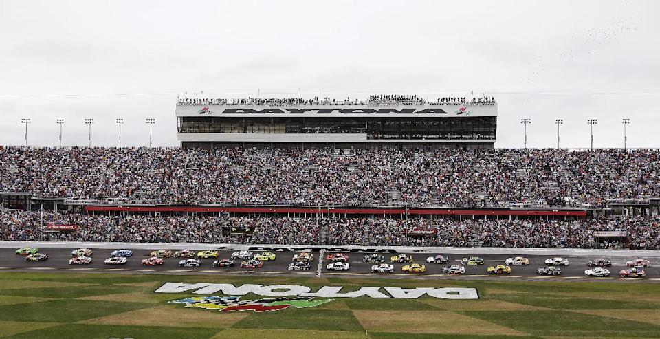 Drivers take the green flag at the start of the Daytona 500 NASCAR Sprint Cup Series auto race, Sunday, Feb. 24, 2013, at Daytona International Speedway in Daytona Beach, Fla. (AP Photo/Chris O'Meara)