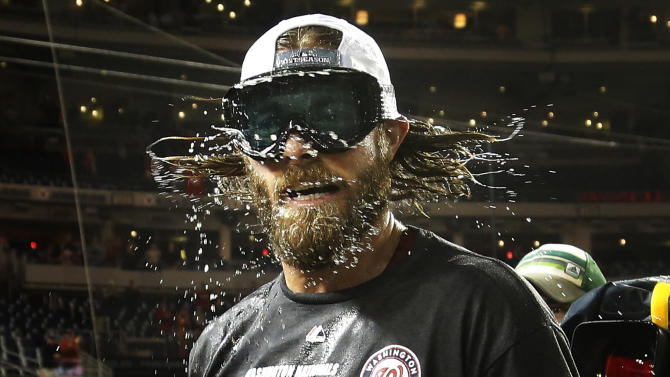 Nationals Werth shakes beer and champagne out of his hair while celebrating with teammates after they clinched the National League East in Washington