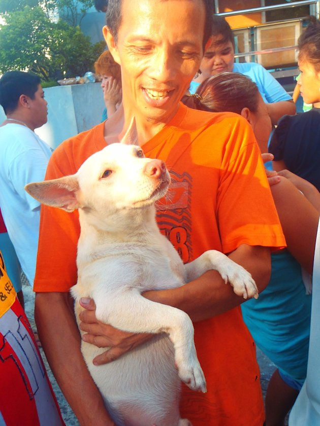 A-grateful-Malabon-resident-with-his-pet-dog-were-among-those-who-received-relief-from-PAWS-team-last-Aug-9-2012-jpg_085655 - About THE PHILIPPINE ANIMAL WELFARE SOCIETY - Directory Philippines