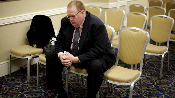 Plaintiff Andrew Druding set by himself after a news conference Tuesday, Sept. 18, 2012, in Philadelphia. Nine plaintiffs allege in civil lawsuits filed Tuesday that the Archdiocese of Philadelphia covered up child sex assault allegations made against seven Roman Catholic priests. (AP Photo/Matt Rourke)