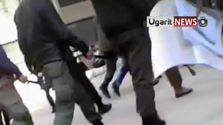 This image from amateur video made available by the Ugarit News group on Wednesday, Dec. 21, 2011, purports to show security forces entering the university in Aleppo, Syria.(AP Photo/Ugarit News Group via APTN) THE ASSOCIATED PRESS CANNOT INDEPENDENTLY VERIFY THE CONTENT, DATE, LOCATION OR AUTHENTICITY OF THIS MATERIAL.  TV OUT