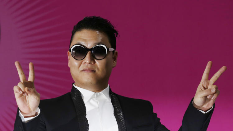 """South Korean rapper PSY poses during a news conference for his concert """"Happening"""" in Seoul, South Korea Saturday, April 13, 2013. PSY is unveiling the music video and choreography for his new single """"Gentleman"""" at the Seoul concert. (AP Photo/Kin Cheung)"""