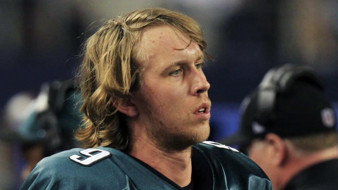 Philadelphia Eagles quarterback Nick Foles (9) watches action against the Dallas Cowboys during the second half of an NFL football game Sunday, Dec. 2, 2012 in Arlington, Texas. Dallas won 38-33. (AP Photo/LM Otero)