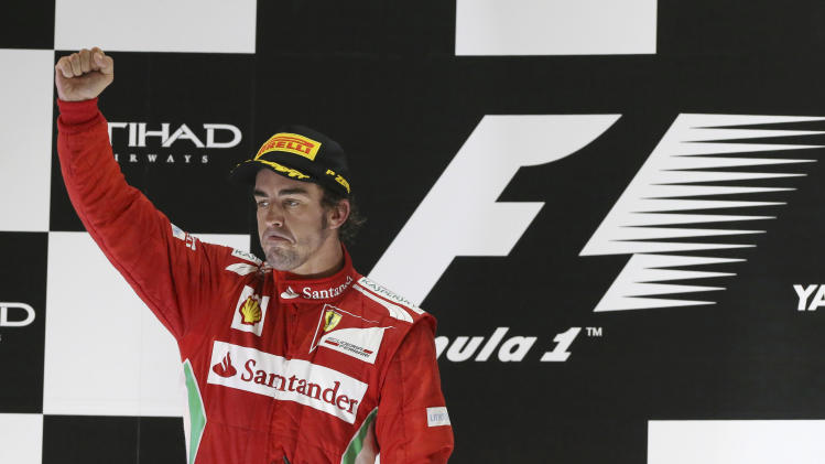 Ferrari driver Fernando Alonso of Spain celebrates on the podium after he finished second in the Emirates Formula One Grand Prix, at the Yas Marina racetrack, in Abu Dhabi, United Arab Emirates, Sunday, Nov. 4, 2012. (AP Photo/Luca Bruno)