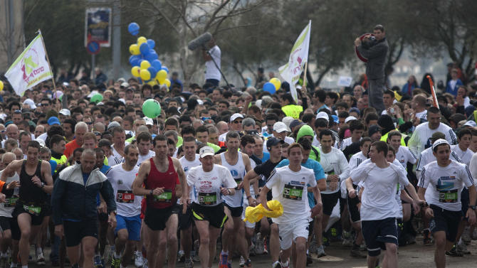 77-year-old Holocaust survivor Hanoch Shahar, front centre left, runs in Jerusalem, Friday, March 16, 2012.  About 15,000 runners, including 1,500 from overseas, are competing Friday, with some 1,000 competitors expecting to complete the full 42 kilometers (26.2 miles) marathon distance, and others aiming to complete shorter distances, including Mayor Nir Barkat who says he plans to run half a marathon and 77-year old Hanoch Shahar aiming for 10Km.  (AP Photo/Sebastian Scheiner)