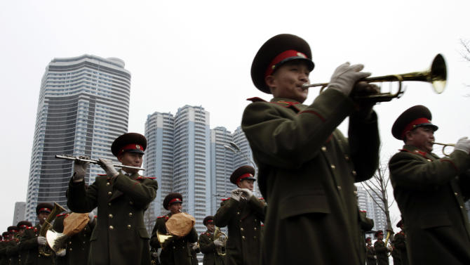 North Korean military band members perform during a mass rally organized to celebrate the success of a rocket launch that sent a satellite into space at Kim Il Sung Square in Pyongyang, North Korea, Friday, Dec. 14, 2012. As the U.S. led international condemnation of what it calls a covert test of missile technology, top North Korean officials denied the allegations and maintained the country's right to develop its space program. (AP Photo/Jon Chol Jin)
