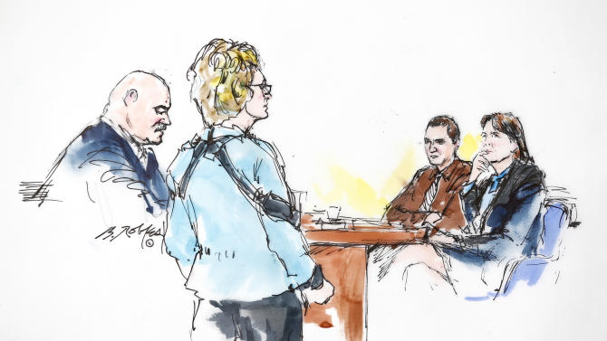 In this courtroom sketch, with his wife former Rep. Gabrielle Giffords, second from left, by his side, Mark Kelly, left, speaks to Jared Loughner, second from right, as he sits next to his attorney Judy Clark during the sentencing of Loughner, at U.S. District Court Thursday, Nov. 8, 2012, in Tucson, Ariz.  District Judge Larry Burns sentenced Loughner, 24, to life in prison, for the January 2011 attack that left six people dead and Giffords and others wounded. Loughner pleaded guilty to federal charges under an agreement that guarantees he will spend the rest of his life in prison without the possibility of parole.  (AP Photo/Bill Robles)