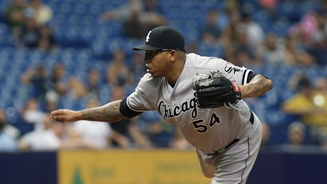 Chicago White Sox relief pitcher Ronald Belisario (54) throws during the ninth inning of a baseball game against the Tampa Bay Rays, Sunday, Sept. 21, 2014, in St. Petersburg, Fla.  (AP Photo/Reinhold Matay)