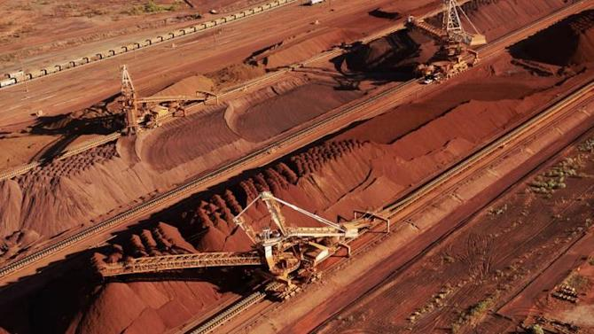 Iron ore is stockpiled for export at Port Hedland in Western Australia on February 9, 2012