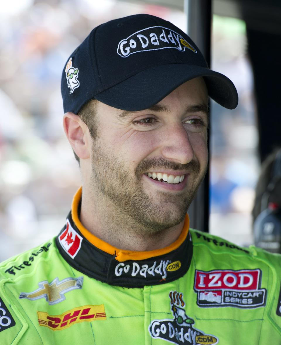 James Hinchcliffe smiles during a break in the first practice session for Indy Toronto auto race on Friday, July 6, 2012, in Toronto. (AP Photo/The Canadian Press, Frank Gunn)