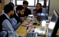 In this Friday, March 29, 2013 photo, Taliban supporters learn to repair mobile phones at Pakistan's army de-radicalization center in Tank, the border town of South Waziristan, the Pakistani tribal area bordering Afghanistan. After battling Taliban militants in the tribal areas bordering Afghanistan for over a decade, the Pakistani military is engaged in a new fight. This time it's for the hearts and minds of the people who are returning to the region after living for years as refugees in their own country and harbor a longstanding mistrust of the central government. (AP Photo/B.K. Bangash)