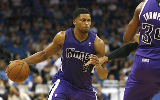 Sacramento Kings forward Rudy Gay (8) drives the ball around teammate Jason Thompson (34) during the second half of an NBA basketball game against the Orlando Magic on Saturday, Dec. 21, 2013, in Orla