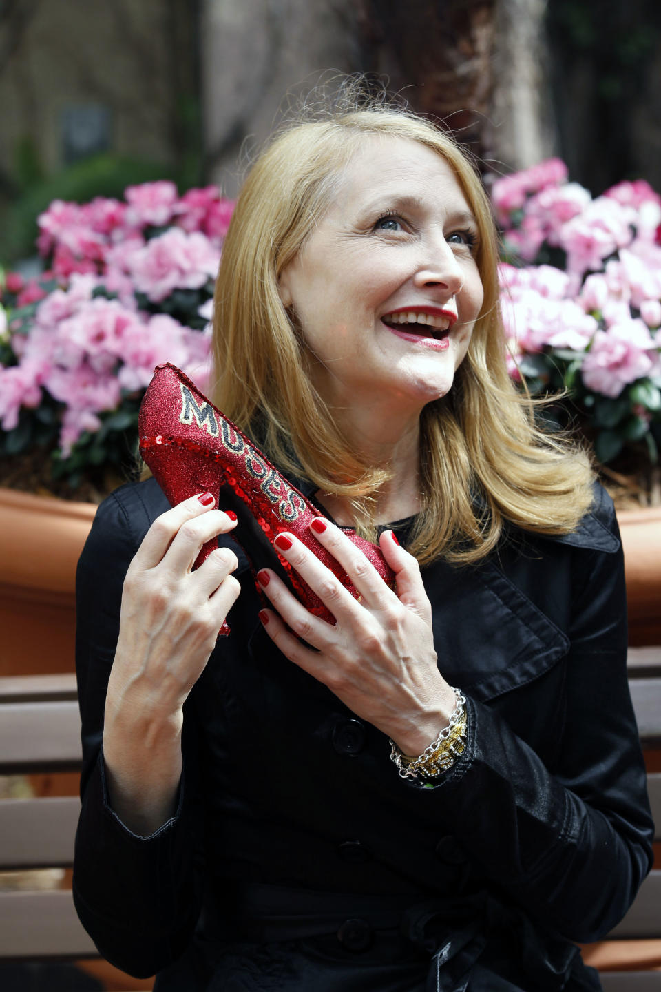 Actress Patricia Clarkson holds a decorated shoe which is the symbol of the Mardi Gras parade Muses in New Orleans,  Wednesday, Feb. 15, 2012. Clarkson will preside over the all-women Mardi Gras Krewe of Muses parade. The parade will march through the streets of the city Thursday night.   (AP Photo/Bill Haber)