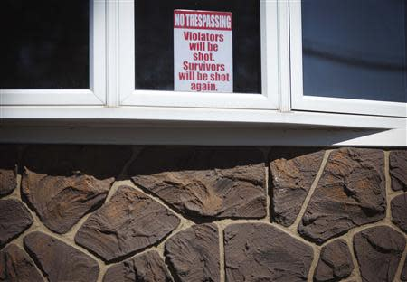 A sign is pictured on the window of a house in the New Dorp Beach area in the Staten Island borough of New York