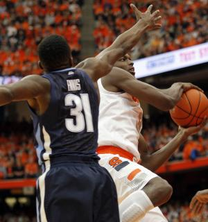 Syracuse's Jerami Grant, right, drives to the basketball against Villanova's Dylan Ennis, left, during the first half of an NCAA college basketball game in Syracuse, N.Y., Saturday, Dec. 28, 2013. (AP Photo/Nick Lisi)