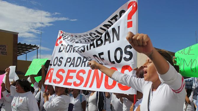 A demonstrator gestures during a march to demand justice in the murder of Christopher Raymundo Marquez in Chihuahua