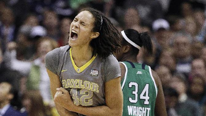 FILE - In this April 3, 2012 file photo, Baylor center Brittney Griner (42) reacts to her shot against Notre Dame during the second half of the NCAA women's Final Four college basketball championship game in Denver. Baylor played 40 games last season and won them all, becoming the seventh team in the NCAA era to finish something-and-oh, and topping the previous record of 39-0 first achieved by Tennessee in 1998 and then matched three times since by Connecticut. (AP Photo/Eric Gay, File)