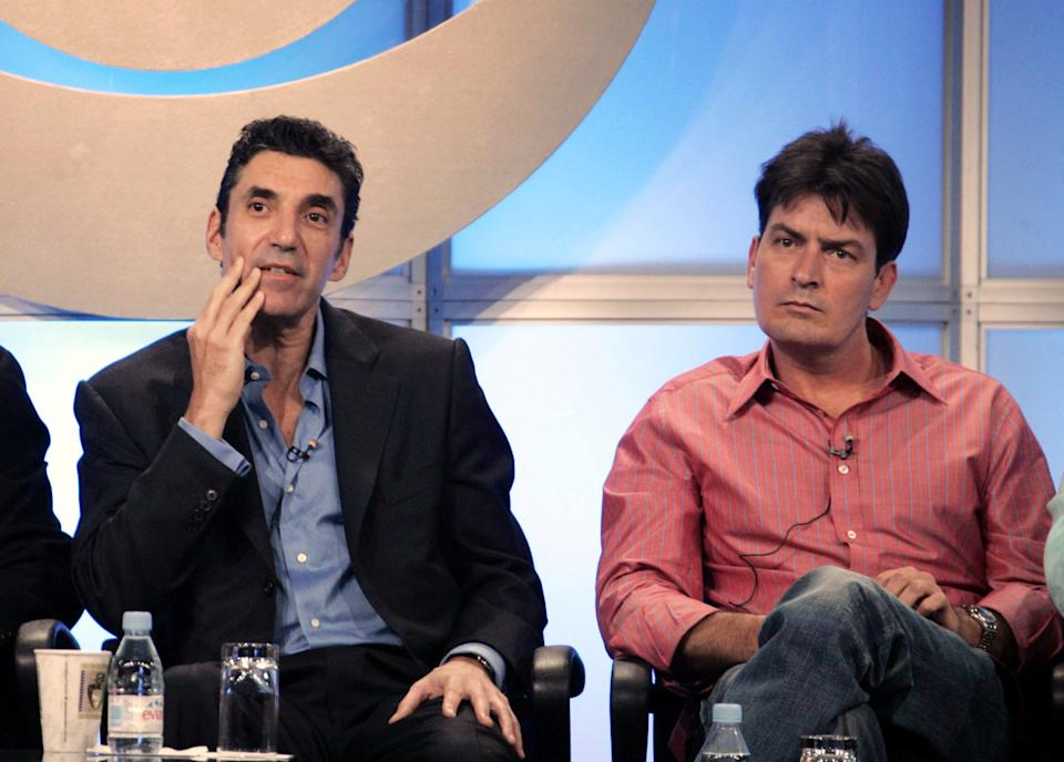 "FILE - In this July 20, 2005 file photo, actor Charlie Sheen, right, co-star of ""Two and a Half Men,"" and Chuck Lorre, executive producer of the show, are shown during the CBS portion of the Television Critics Association press tour in Beverly Hills, Calif. (AP Photo/Nick Ut, file)"