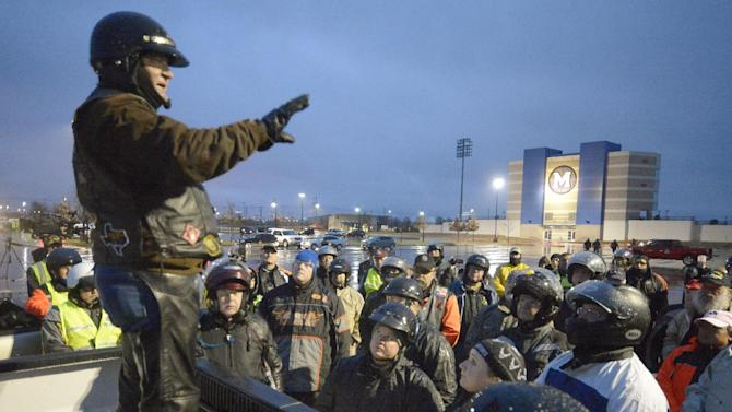 Larry Key gives instructions to the Patriot Guard Riders before the procession for Chris Kyle at Multi-Purpose Stadium, in Midlothian,Texas, Tuesday, Feb. 12, 2013 for the 200-mile journey to Austin, where Kyle will be buried at the Texas State Cemetery. Some 7,000 people attended a two-hour memorial service for Kyle at Cowboys Stadium in Arlington on Monday. Kyle and his friend Chad Littlefield were shot and killed Feb 2. at a North Texas gun range. (AP Photo/Star-Telegram, Max Faulkner)