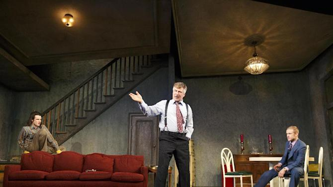 """This theater image released by Boneau/Bryan-Brown shows, from left, Tom Sturridge, Alec Baldwin, and Ben Foster during a performance of """"Orphans,"""" at the Gerald Schoenfeld Theatre in New York. (AP Photo/Boneau/Bryan-Brown, Joan Marcus)"""