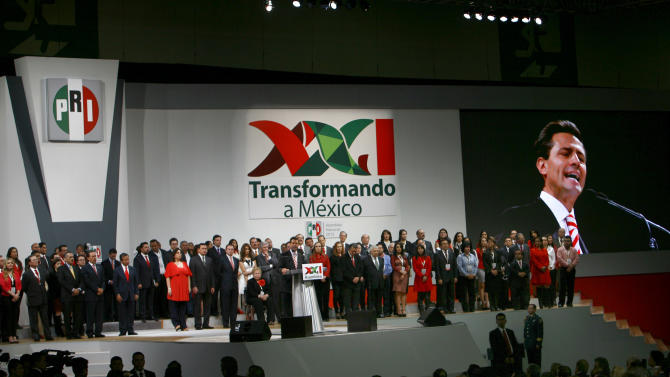 FILE - In this March 3, 2013 file photo, Mexico's President Enrique Pena Nieto delivers a speech during a national convention of his Institutional Revolutionary Party (PRI) in Mexico City. Pena Nieto has been fast out of the blocks in attacking some of Mexico's toughest issues in a country often stymied by monopolies and corruption. He says his plan will make the country more democratic and competitive in the world economy, and his drive for reform is fueling international confidence about Mexico. (AP Photo/Marco Ugarte, file)