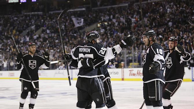 Los Angeles Kings' Slava Voynov (26), of Russia, celebrates his goal with teammates during the second period in Game 3 of a first-round NHL hockey Stanley Cup playoff series against the St. Louis Blues in Los Angeles, Saturday, May 4, 2013. (AP Photo/Jae C. Hong)