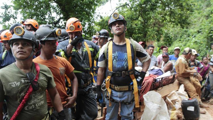 Rescuers wait to go inside a gold mine where miners are trapped after heavy rains caused a landslide in Bonanza town, in northern Nicaragua