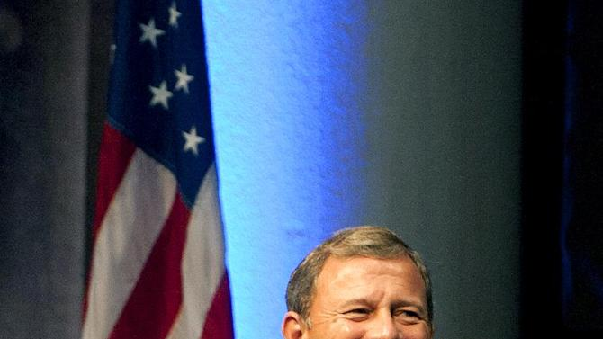 """U.S. Supreme Court Chief Justice John Roberts smiles before """"A Conversation With the Chief Justice"""" at Rice University Wednesday, Oct. 17, 2012, in Houston. Roberts was invited to speak in celebration of Rice's Centennial Celebration and Centennial Lecture Series. (AP Photo/Houston Chronicle, Cody Duty)"""