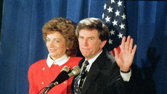 FILE - In this March 11, 1988, file photo, Democratic presidential candidate Gary Hart waves to supporters at a news conference in Denver, after announcing he would withdraw from the 1988 presidential race for the second time.  At his side is his wife, Lee. Herman Cain drew a line in the sand, and now he has to hope it sets like concrete. Cain, a surprise leader in recent Republican presidential polls, has responded to allegations of sexual harassment with a series of definitive statements that invite closer scrutiny of his past conduct. Any number of politicians past were derailed after issuing a public invitation to check out their conduct, none more famously than Hart. (AP Photo/Aaron E. Tomlinson, File)