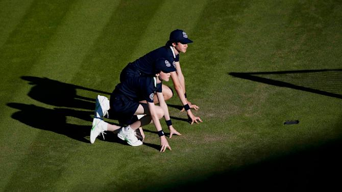 Ball boys wait on Court 1 at the Wimbledon Tennis Championships in London