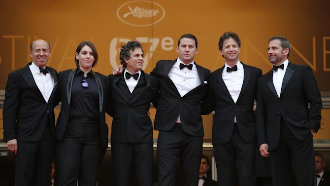 From left, producers Jon Kilik, Megan Ellison, actor Mark Ruffalo, actor Channing Tatum, director Bennett Miller and actor Steve Carell pose for photographers as they arrive for the screening of Foxcatcher at the 67th international film festival, Cannes, southern France, Monday, May 19, 2014. (AP Photo/Alastair Grant)