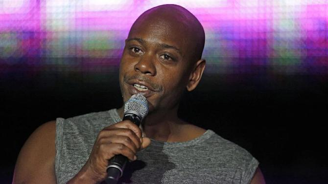 FILE - This Sunday, July 6, 2014 file photo Dave Chappelle performs at the Essence Festival in New Orleans. Santa Fe police say a man tossed a banana peel at Chappelle during a show, hitting in the comedian in the leg. Police Lt. Andrea Dobyns says 30-year-old Christian Englander of Santa Fe was arrested on suspicion of misdemeanor disorderly conduct and battery after the fruit throw Monday, March 30, 2015 at the Lensic Performing Arts Center in the northern New Mexico city. (AP Photo/Gerald Herbert,File)