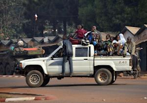 Chadian civilians sit in the back of a pick up truck …